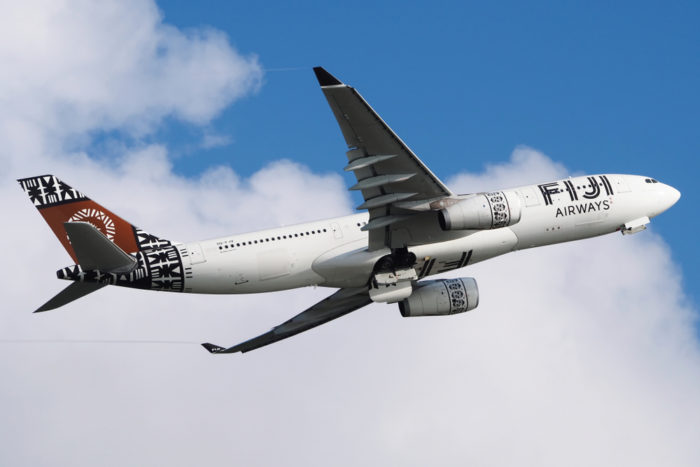 A Fiji Airways plane flying in the sky.