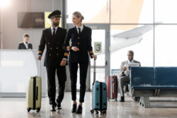 Two pilots walking in airport.